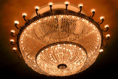 Theater ceiling with illuminated crystal chandelier Stock Photos