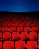 Theater Chairs. A Dark theater hall showing the seats Stock Images