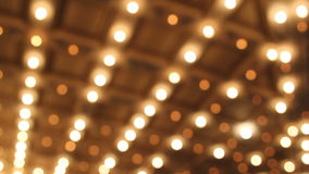 Theater and Concert Hall Ceiling with Blurred Bokeh Retro Flashing Marquee Lights in Downtown 1080p. Theater and Concert Hall Ceiling with Blurred Bokeh Retro