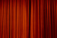 Theater Curtain. A gathered curtain on the stage of a theater texture Stock Images