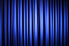 Theater Curtain. Spotlight on  A Blue Theater Curtain Before Show Begins Royalty Free Stock Photos