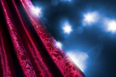 Theater curtain with dramatic lighting Stock Images