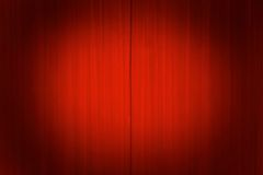 Theater curtains with a spotlight. Bright red theater curtains with a spotlight on the center Royalty Free Stock Photography