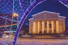 Theater decorated for the new year with garlands in the evening royalty free stock image