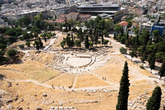 Theater of Dionysus, Athens, Greece. Theatre of Dionysus and modern Athens behind it, Greece Stock Photography