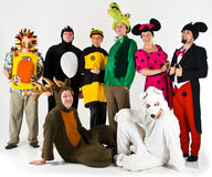 Theater Entertainment Group. A theatrical entertainment group. Costumes including Sonic the hedgehog, penguin, bumble bee, crocodile, minnie and mickey mouse and Royalty Free Stock Images