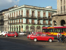Buildings Havana Cuba cars bus sky road tropical  travel Royalty Free Stock Photography