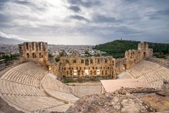 The theater of Herodion Atticus under the ruins of Acropolis, Athens. The theater of Herodion Atticus under the ruins of Acropolis, Athens, Greece Stock Photo