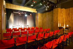 Theater interior with red chairs. Nobody Stock Photo