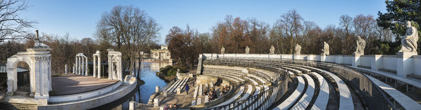 Theater on the Isle in Lazienki Park. Panoramic view of Theater on the Isle on the bank of the Lazienki lake, Park in Warsaw, Poland royalty free stock photo