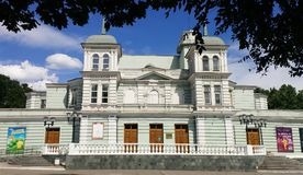Theater Lesia Ukrainka, the blue sky, beautiful clouds. Green trees, the theater is located in the city of Kamenskoye, Dnipropetrovsk region, Ukraine Royalty Free Stock Photos