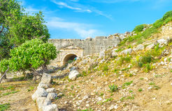 The theater of Letoon. The sidewall of ancient theater with arched corridor, Letoon, Turkey Royalty Free Stock Photography