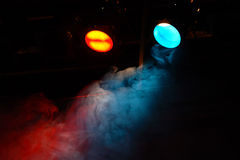 Theater lights. Red and blue theater lights with smoke Stock Photos