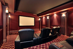 Theater in luxury home. With large leather chairs Stock Photos