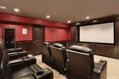 Theater in luxury home. With red walls Royalty Free Stock Image