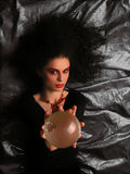 Theater MakeUp - Witch. Lady With MakeUp and Crystal Ball on blue background royalty free stock images