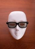 Theater mask in glasses on the table Stock Photo