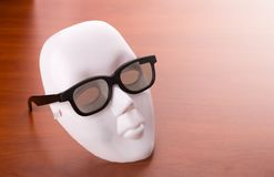 Theater mask in glasses on the table Royalty Free Stock Images