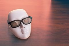 Theater mask in glasses Royalty Free Stock Photo