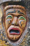 Theater  mask sad. A carving of a theater mask that has a sad face Royalty Free Stock Photos