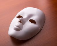 Theater mask on the table Royalty Free Stock Photography