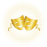 Theater masks. Gold masks representing theater comedy and drama over star burst background Royalty Free Stock Photography
