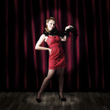 Theater Performer In Front Of Red Stage Curtains Royalty Free Stock Photos