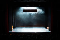 Theater play. Empty scene during the theatrical play filled with the smoke Stock Image