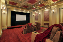 Theater with plush red carpeting Stock Image