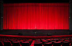 Theater red curtain. Stage red curtain over wooden floor Stock Image