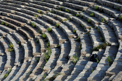 Theater Rows In Ephesus. Rows of theater in Ephesus, Turkey, overrun with weeds and backpack Royalty Free Stock Image