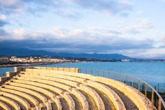 Theater on the sea with cloudy blue sky Stock Photo