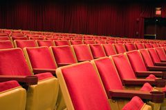Theater seating. Rows of bright red seats Royalty Free Stock Photography