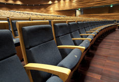 Theater seats. Emissions neat theater seats, waiting for the audience seated Stock Image