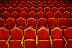 Theater seats. A background with the rows of red seats in a theater Stock Photography