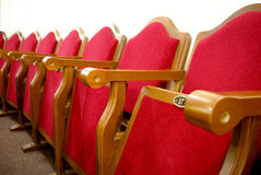 Theater seats. Red velvet row of theater seats Stock Images