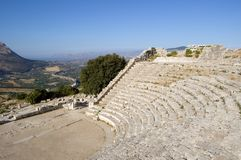 The Theater of Segesta in Sicily. The Theater of Segesta (3th century BC) dominates the valley; Sicily, Italy Royalty Free Stock Photo
