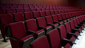 Theater sits. Many lines of theater sits in red, plastic sits used in a local small theater in mexico, small cushing sits for the audience Stock Photography