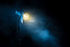 Theater spot light on black background. Theater spot light on black background with smoke Stock Photos