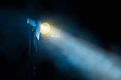 Theater spot light on black background. royalty free stock images