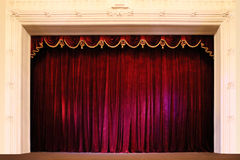 Theater stage. Closed crumpled red curtain over empty theater stage Royalty Free Stock Photography