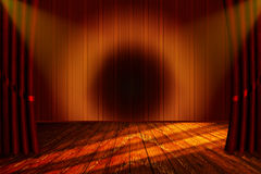 Theater with a stage and cutains with yellow light Stock Photography