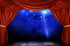 Theater stage with red curtain Stock Images