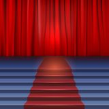 Theater stage with red curtain and carpet. Stock Image