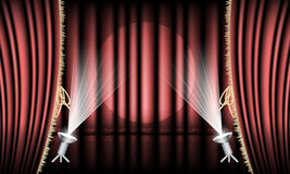 Theater stage with red curtain, gold hem and spotlights. Royalty Free Stock Photos