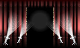 Theater stage with red curtain, gold hem and spotlights. Stock Photography