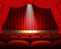 A theater stage with a red curtain, seats and a spotlight Royalty Free Stock Photos