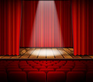 A theater stage with a red curtain Stock Photos