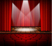 Theater stage with a red curtain Royalty Free Stock Photos