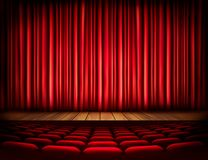 A theater stage with a red curtain, seats. Royalty Free Stock Image